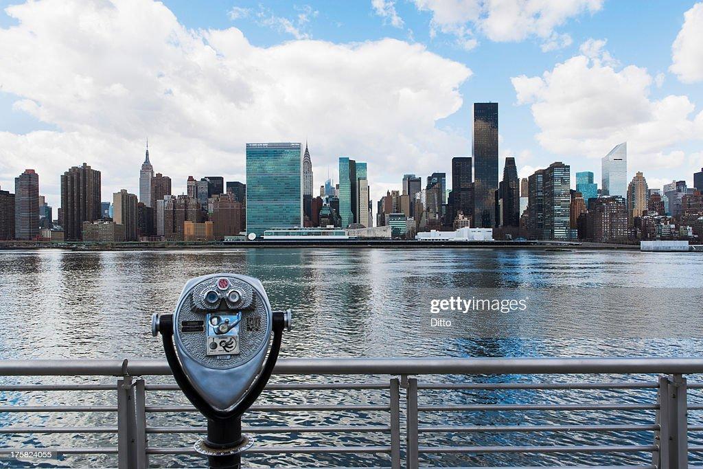 Coin operated binoculars and skyline of New York City : Stock Photo