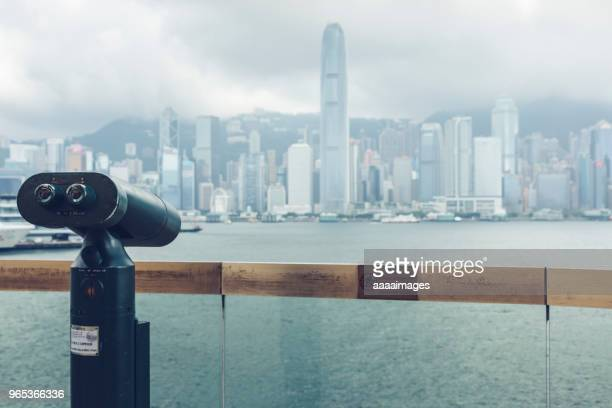 Coin operated telescope with victoria harbor on background,Hong Kong