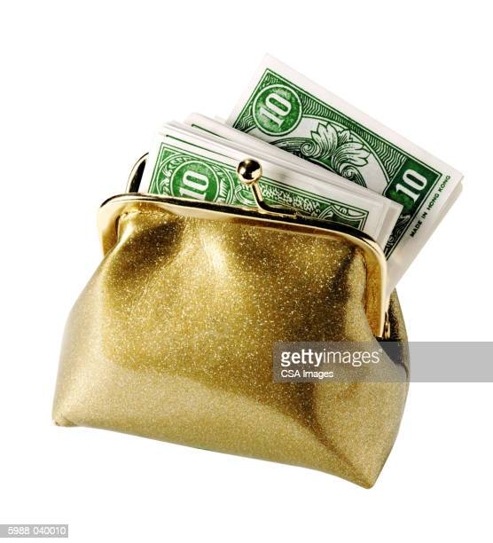 coin purse with play money - gold purse stock pictures, royalty-free photos & images