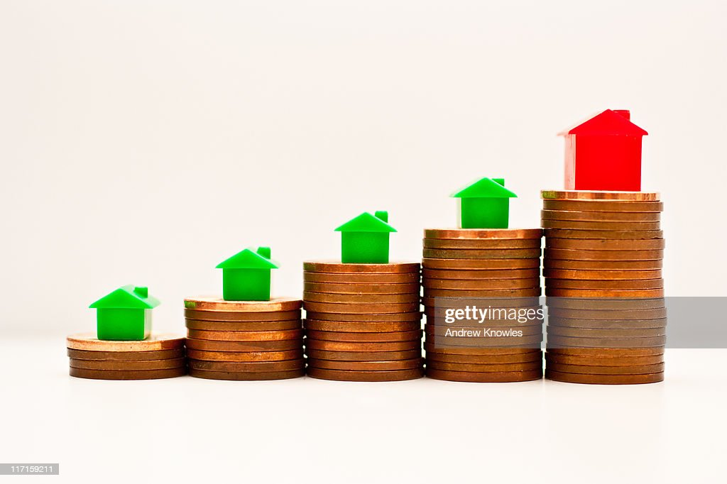Coin stacks of Increasing height : Stock Photo