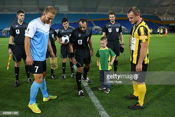 Coin toss before the start of the FFA Cup match between the Palm Beach Sharks and South Springvale at CBUS Stadium on September 23 2014 in Brisbane...