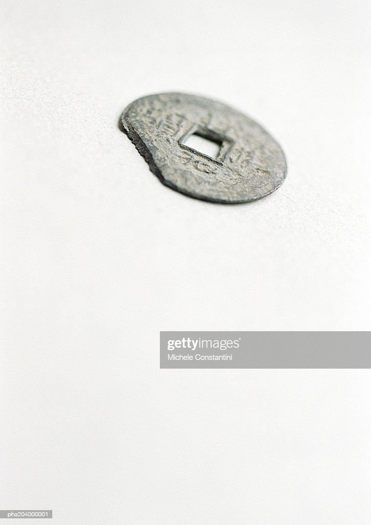 Coin with hole in middle. : Stockfoto