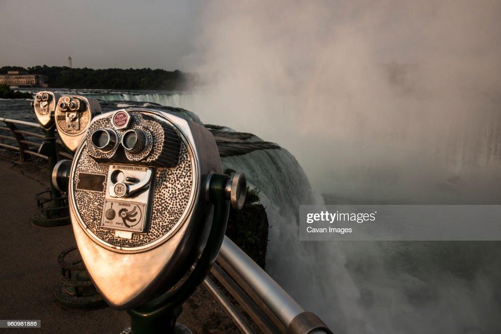 Coin-operated binoculars against Niagara falls : Stock Photo