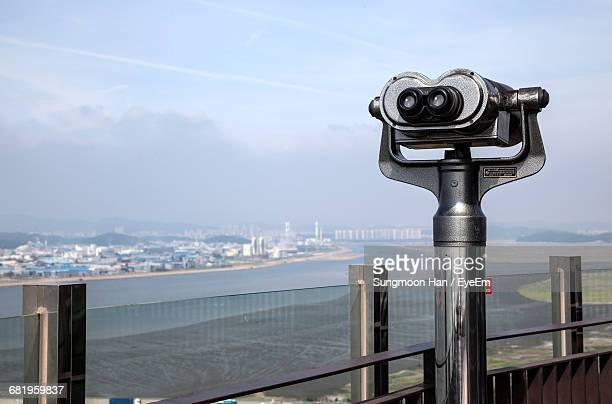 Coin-Operated Binoculars At Observation Point Against Sky