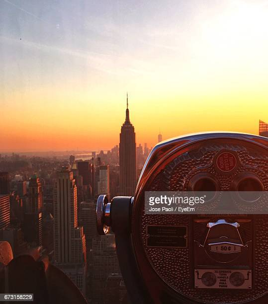 Coin-Operated Binoculars At Observation Point During Sunset