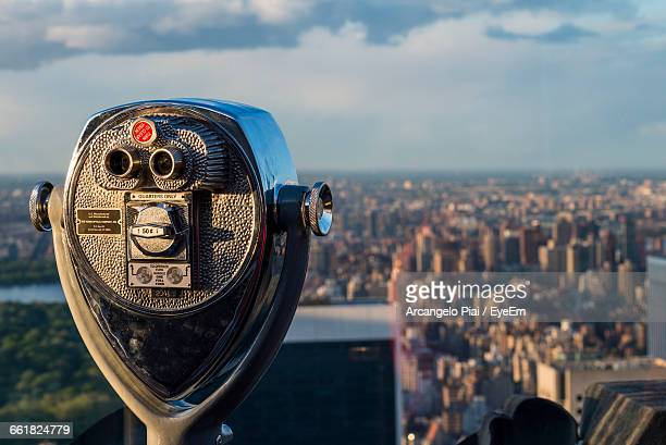 Coin-Operated Binoculars In City Against Sky On Sunny Day