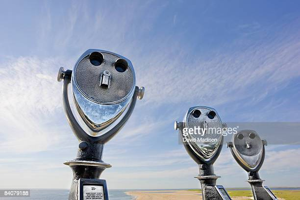 Coin-operated binoculars on beach.