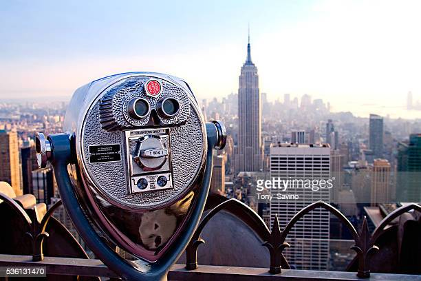 Coinoperated binoculars positioned looking south towards the Empire State Building and lower Manhattan on the observation deck of the Rockefeller...