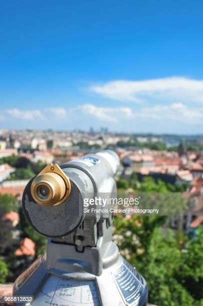 Coin-operated telescope overlooking Prague's landmarks in Czech Republic, a UNESCO heritage site