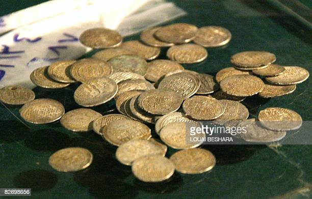 Coins are put on display some of the 700 Iraqi antiquities which have been in the care of Syria authorities at the National Syrian Museum in Damascus...