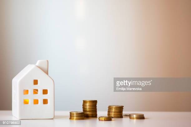 Coins Currency Pile and Ceramic White house