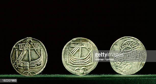 Coins depicting Viking longships Probably minted at Hedeby DenmarkThey were found in the Viking market place at Birka Sweden early 9th century Viking...