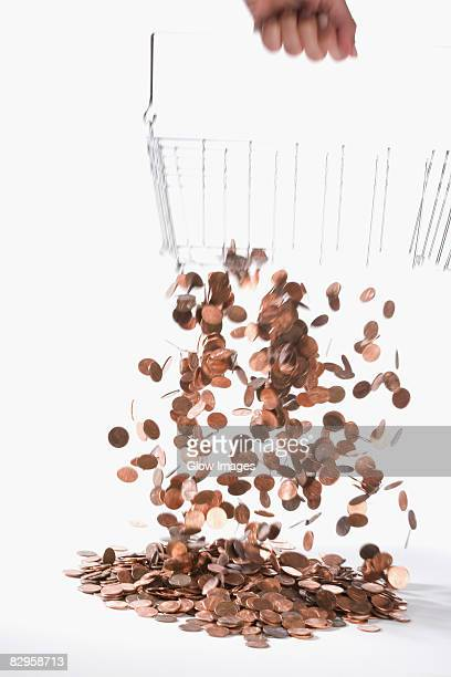 Coins draining from a metal basket