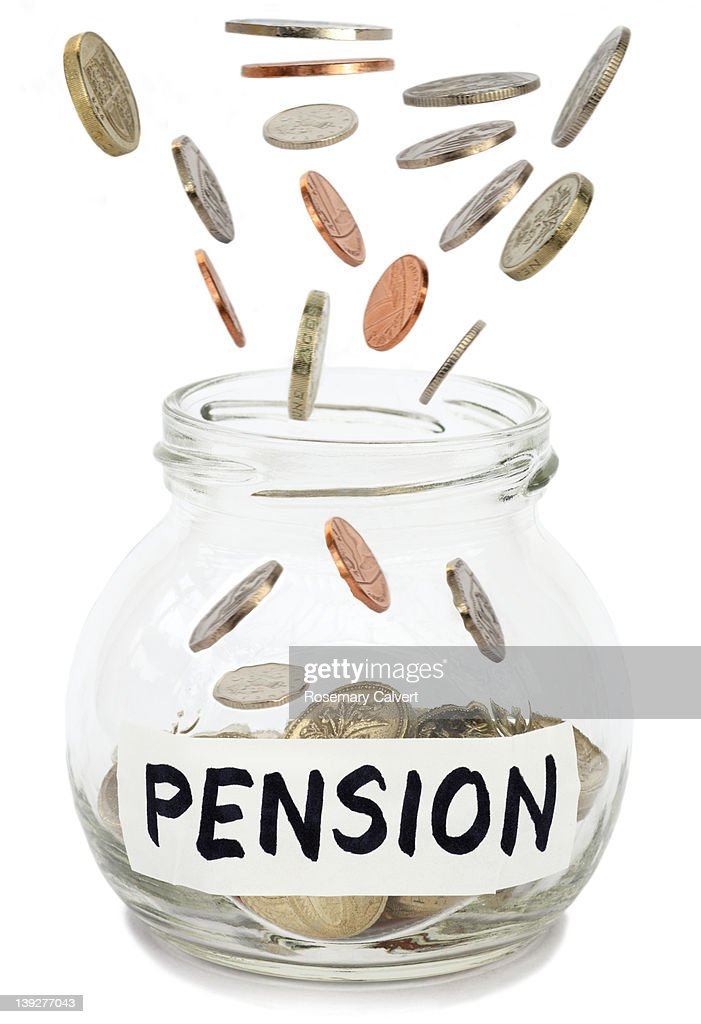 Coins falling into jam jar labelled pension. : Stock Photo