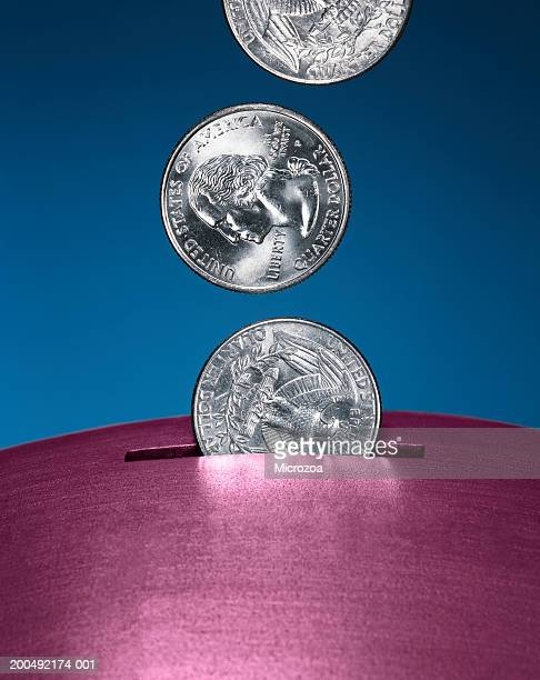 coins falling into slot - microzoa stock pictures, royalty-free photos & images
