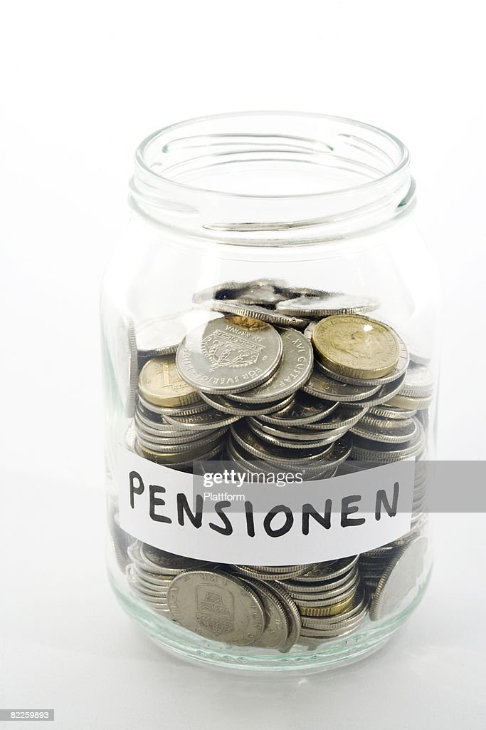 Coins in a glass jar. : Stock Photo