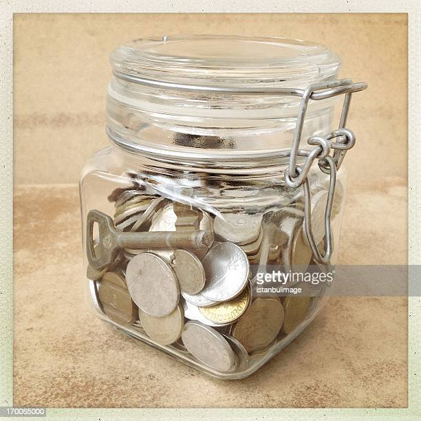 coins in a jar isolated