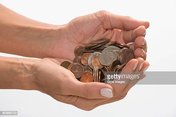 Coins in a person's hands cupped