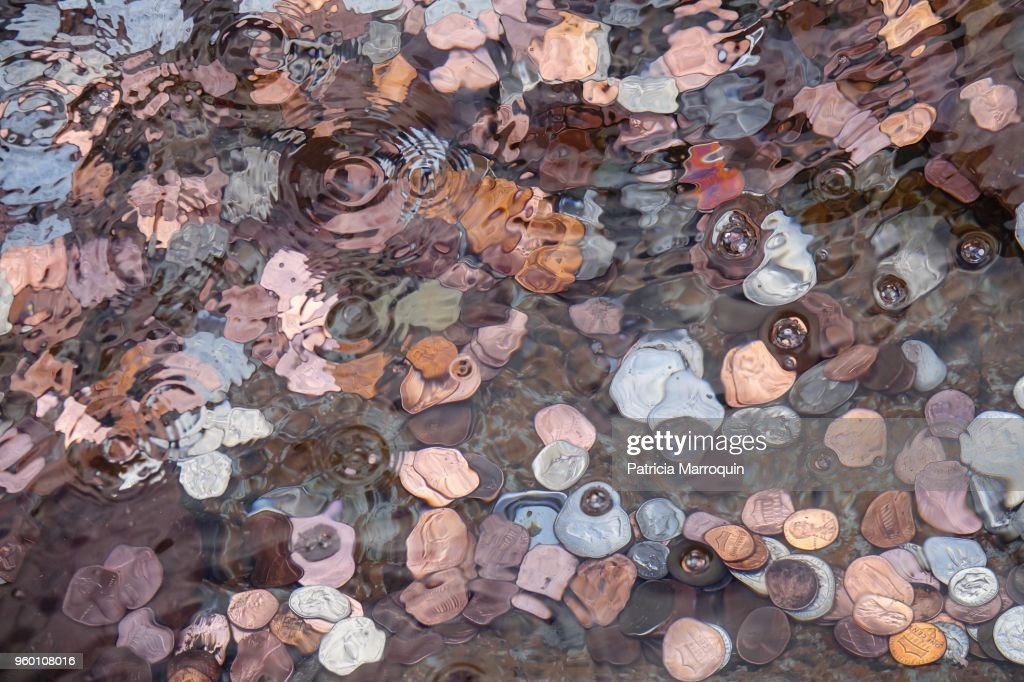Coins in a Wishing Well : Stock-Foto