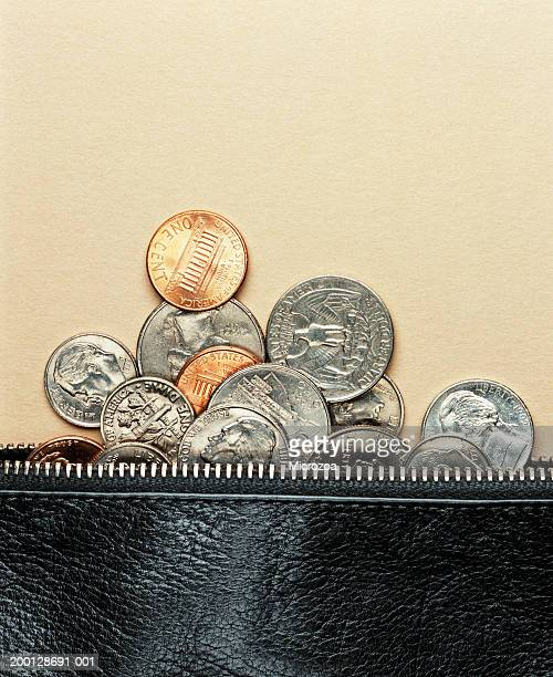 us coins in and around zip of purse - microzoa stock pictures, royalty-free photos & images