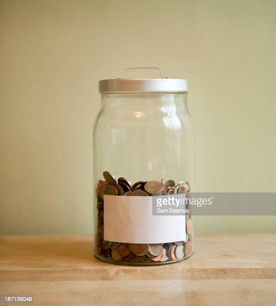 Coins in blank labeled jar