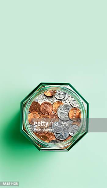 us coins in savings jar. - us coin stock pictures, royalty-free photos & images