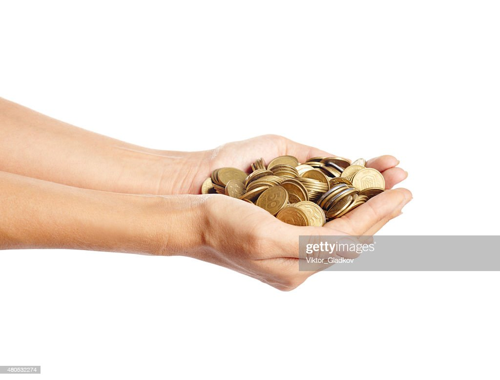 Coins in the hands : Stockfoto