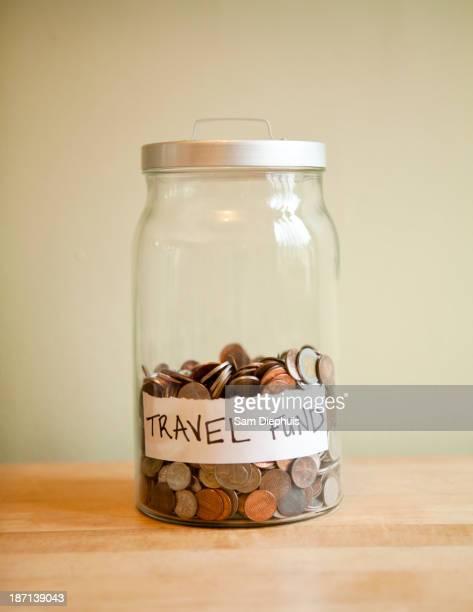 Coins in 'travel fund' jar