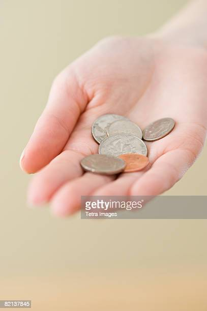Coins in woman?s hand