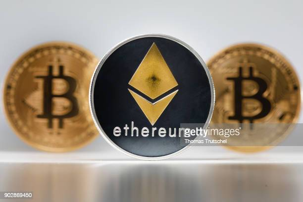 Coins of the cryptocurrencies Ethereum and Bitcoin stands on a table on January 09 2018 in Berlin Germany