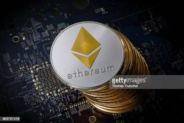 Coins of the cryptocurrency Ethereum lie on a circuit board of a computer on January 11 2018 in Berlin Germany