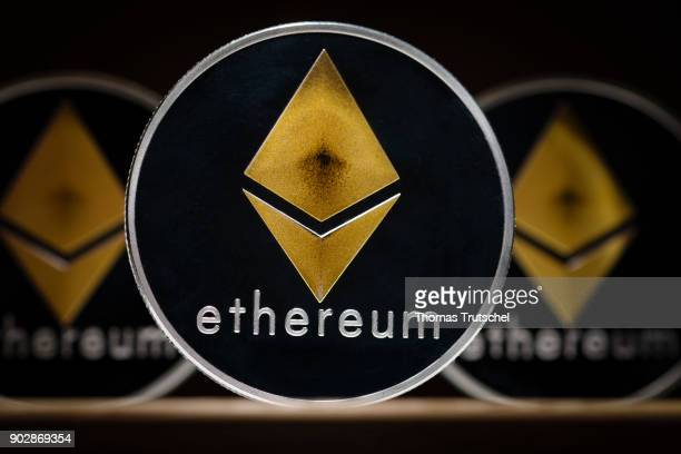 Coins of the cryptocurrency Ethereum stands on a table on January 09 2018 in Berlin Germany