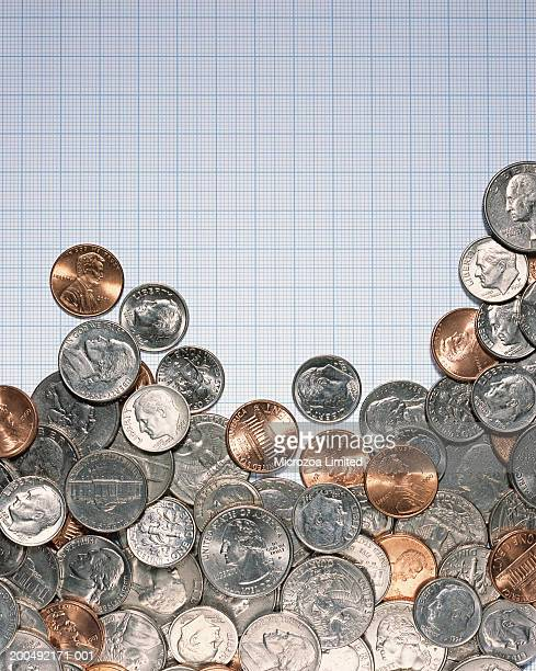 coins on graph paper - microzoa stock pictures, royalty-free photos & images