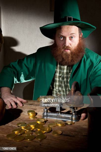 coins on table of leprechaun - leprechaun stock pictures, royalty-free photos & images