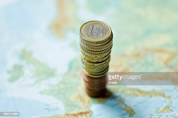 Münzen auf der Karte von Europa