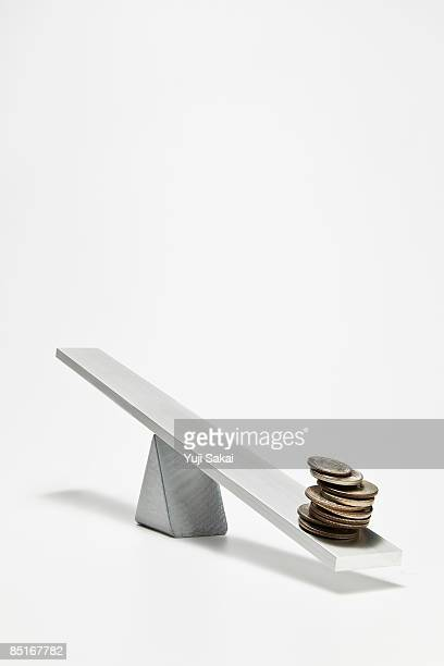 coins on the seesaw