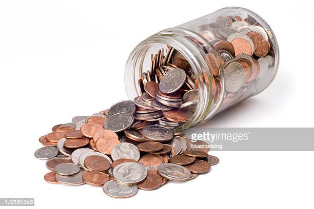 coins spilling from a jar - jar stock pictures, royalty-free photos & images