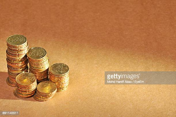 Coins Stacked On Table