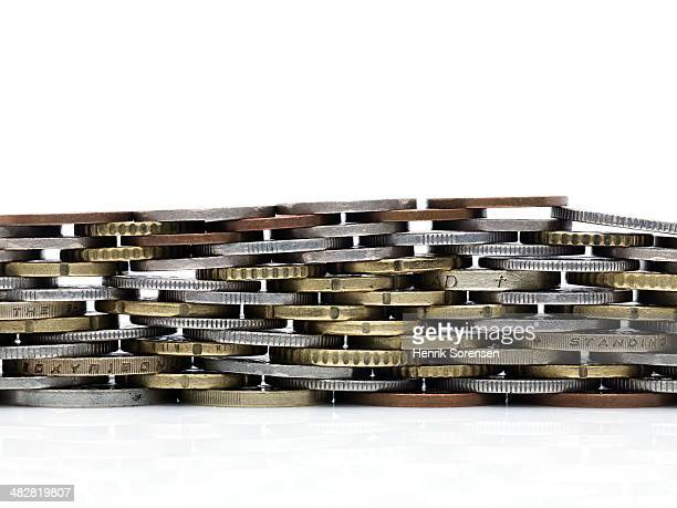 Coins stacked to form a wall