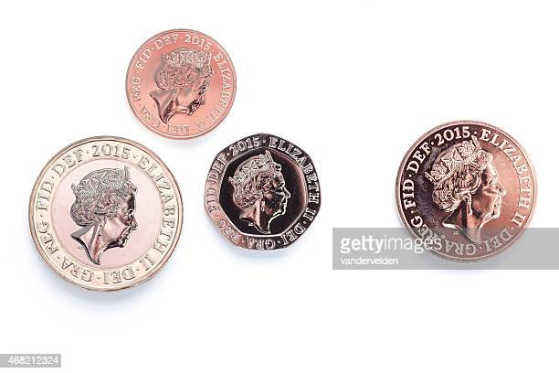 2015 coins with updated queen's head - british royal family stock photos and pictures