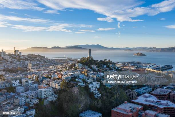 coit tower aerial with alcatraz - north beach san francisco stock pictures, royalty-free photos & images