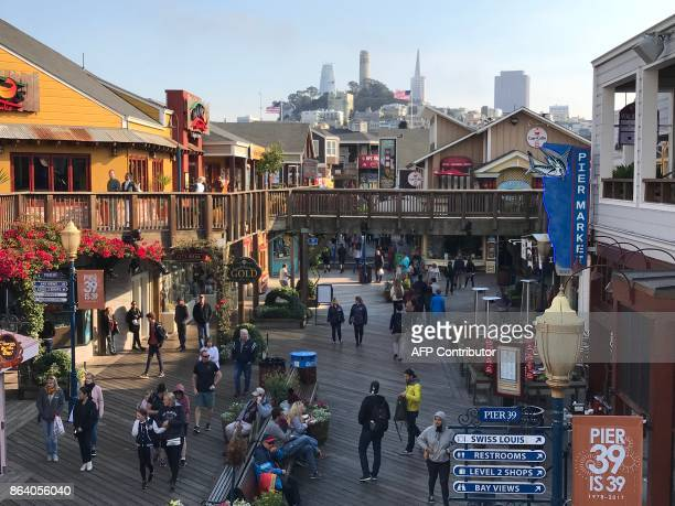 Coit tower Transamerica Pyramid are seen from Pier 39 at San Francisco Fisherman Wharf on October 18 2017 / AFP PHOTO / Daniel SLIM