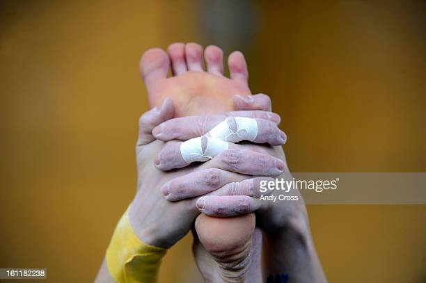 Jain Kim, from Korea, stretches her leg and foot before making another attempt at the climbing wall during the IFSC Bouldering World Cup semi-finals...