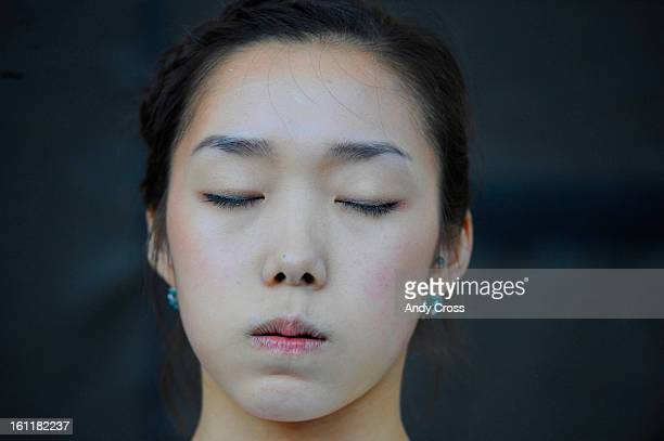 Jain Kim, from Korea, takes a moment to gather her thoughts before making another attempt at the climbing wall during the IFSC Bouldering World Cup...