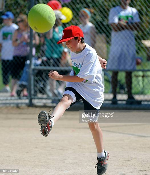 DENVER COJosh Van Bramer 10yearsold kicks the ball into play during the 3rd annual McKaila Ball a kickball party at the Colorado Rockies Fast pitch...