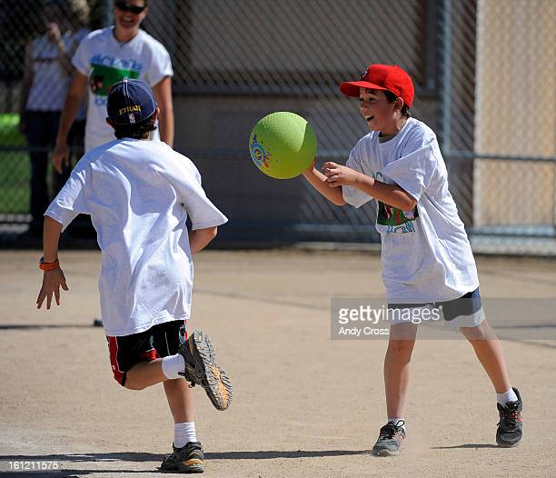 DENVER COJosh Van Bramer 10yearsold right throws the ball at runner Ethan Ogden 12yearsold for an out at home plate during the 3rd annual McKaila...