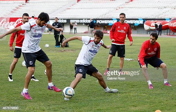 Coke Andujar practices with his teammates Alejandro Arribas and Nicolas Pareja of Sevilla FC during a training session at Monumental Antonio Vespucio...