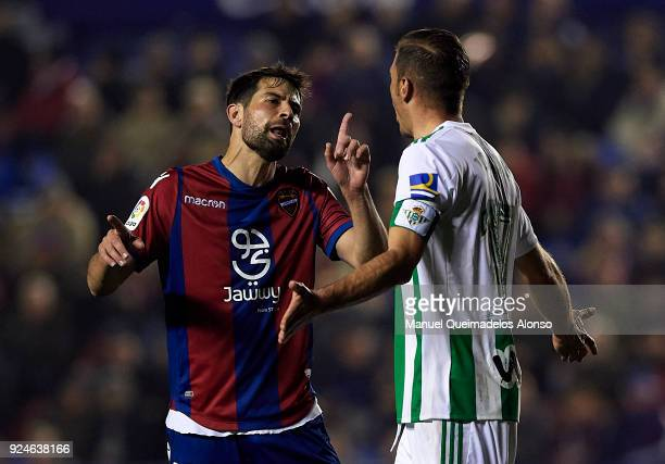 Coke of Levante and Joaquin Sanchez of Betis argue during the La Liga match between Levante and Real Betis at Ciudad de Valencia Stadium on February...