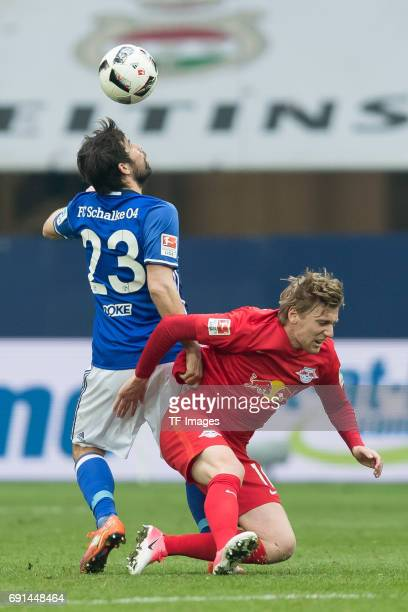Coke of Schalke and Emil Forsberg of Leipzig battle for the ball during the Bundesliga match between FC Schalke 04 and RB Leipzig at VeltinsArena on...
