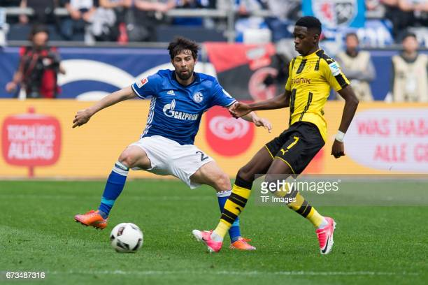 Coke of Schalke and Ousmane Dembele of Dortmund battle for the ball during the Bundesliga match between FC Schalke 04 and Borussia Dortmund at...
